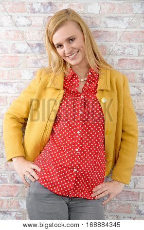 a beautiful young blonde woman with a yellow jacket