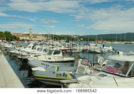 Krk Croatia - September 19 2016: a town in the south of the island of Krk. It is a tourist resort preserved fragments of buildings from Roman times. Harbor. On the waterfront moored many boats and yachts.