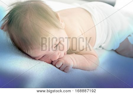 Beautiful Newborn Baby Resting On Warm Blue Blanket