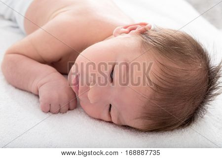 Portrait Of Beautiful Baby With Hair On Her Head Resting