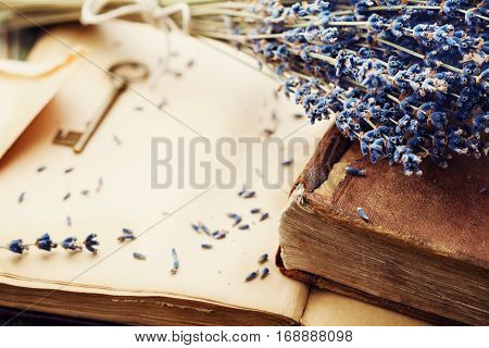 Retro still life with vintage books key and lavender flowers nostalgic composition.