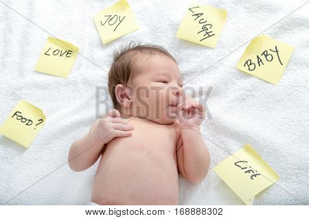 Baby Presenting Love And Care With Surrounding Post It Stickers
