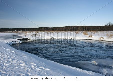 Winter landscape of snow-covered fields trees and rivers