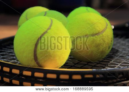 close up view of tennis balls and racket