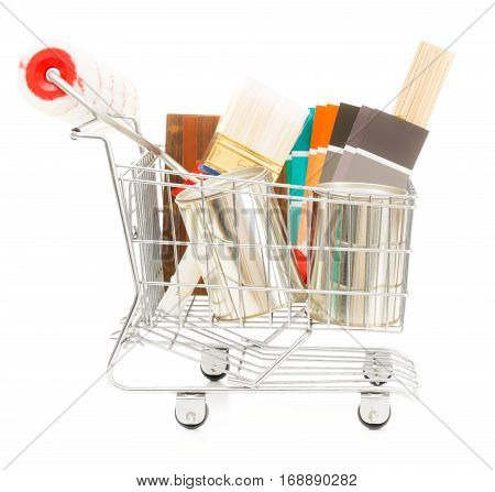 shopping cart with wall paint, paint brushes, color swatches and other stuff neessary for redesigning your home