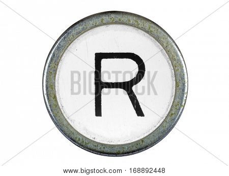 Vintage typewriter letter R isolated on white