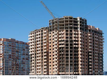 The new multi-storey semi-circular house against the sky