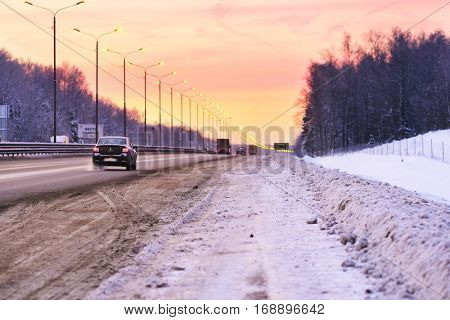 Moscow region, Russia - January, 10, 2016: car on a country road in the frozen winter morning