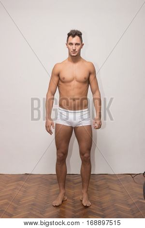 young adult man model, snapshot full body length, shirtless