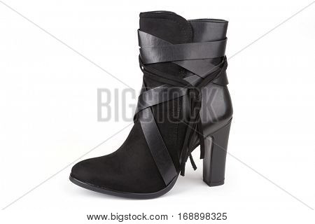 Black ankle boot with a tassel isolated on white (with shadow)