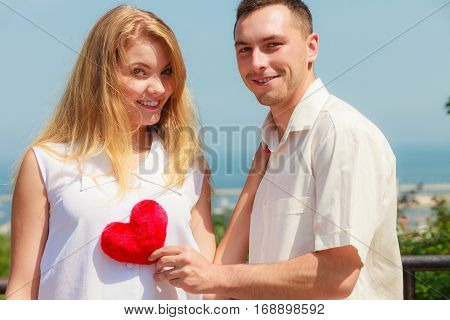Happy Romantic Couple With Holding Heart