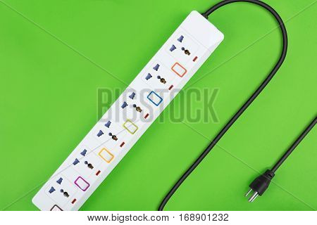 Electrical power strip or extension block and empty outlet tap with switch grounded top view on colorful background and copy space electric equipment flat lay concept.