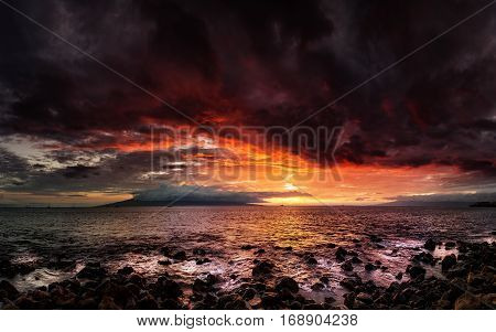 A dramatic sunset looking over the Pacific Ocean, Maui, Hawaii.