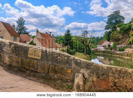Bridge Pinard in picturesque medieval town of Semur en Auxois Burgundy France. The traslation of the words on the plate is 'Bridge Pinard' 'Commune of Semur en Auxois'