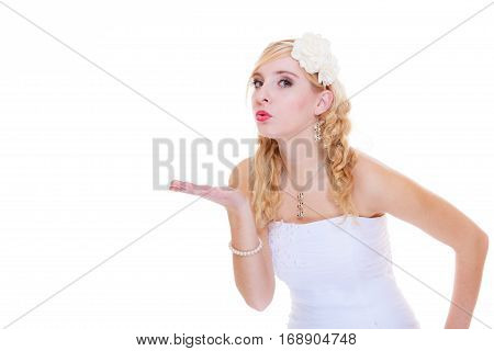 Wedding celebration concept. Happy bride posing for marriage photo waiting for the big day sending air kiss
