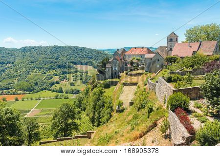 View of the picturesque medieval village in valley. Chalon Departement Jura Franche-Comte France