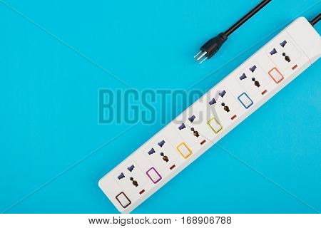 Electrical power strip or extension block and empty outlet tap with switch grounded top view on colorful background electric equipment flat lay concept.