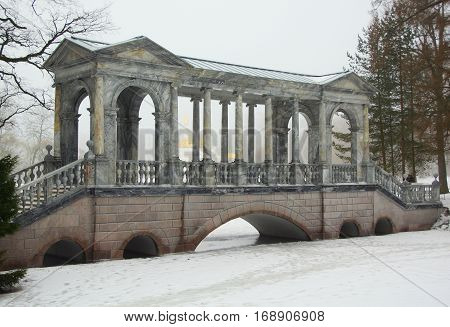 Siberian bridge and a thaw in January in the Catherine park in Tsarskoye Selo