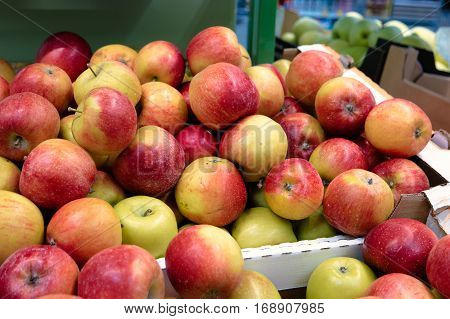 Many red apples in mall on sale closeup shot vintage color-look
