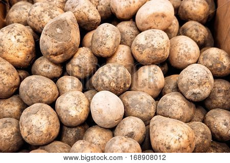 Young organic potato background, selling potato in grocery store vintage color-look