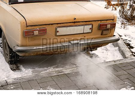 Old car smoking, environmentally dangerous vehicle vintage color-look
