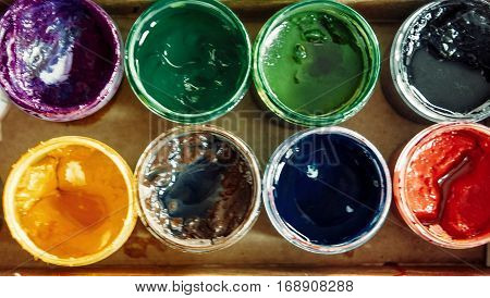 A Lot of bright colours in jars above view vintage color-look