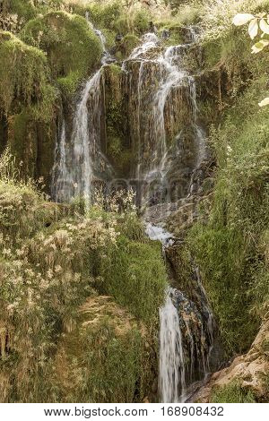 Beautiful waterfall, cascade in valley Chateau-Chalon. Chalon, Departement Jura, Franche-Comte, France