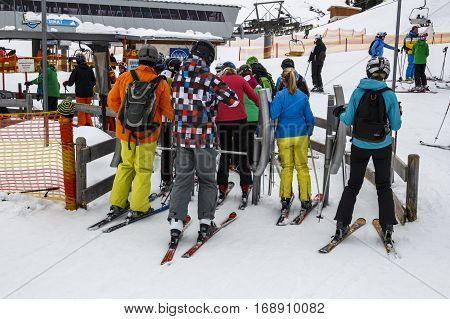 HINTERTUX, AUSTRIA - MARCH 29, 2015: The ski lift Sun Jet at the Horberg mountain in Tyrol Austria with people in the queue for a lift to the mountaintop