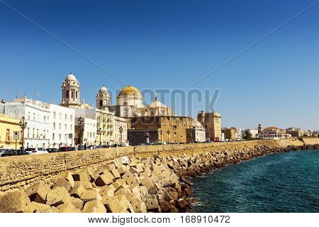 CADIZ, SPAIN - SEPTEMBER 27: Seafront view of Cadiz with historic cathedral on September 27, 2017.