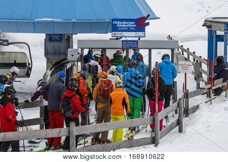 HINTERTUX, AUSTRIA - MARCH 29, 2015: The ski lift Nordhangbahn at the Horberg mountain in Tyrol Austria with people in the queue for a lift to the mountaintop