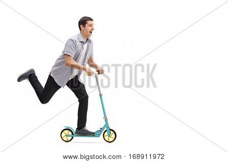 Full length portrait of an overjoyed guy riding a scooter isolated on white background