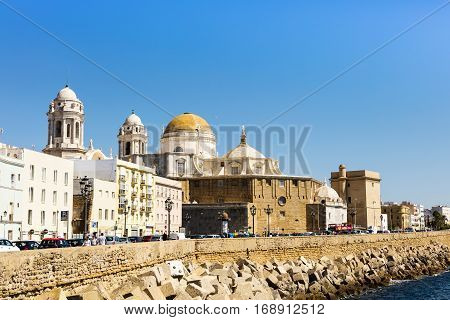 CADIZ, SPAIN - SEPTEMBER 27: Seafront view of Cadiz with historic cathedral on September 27, 2016.