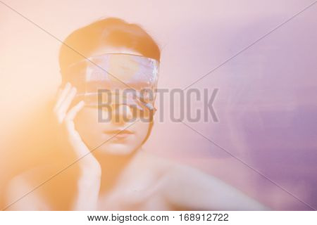 Portrait Of A Woman With Covered Eyes In Rays Of Light. Technique Mixed Light