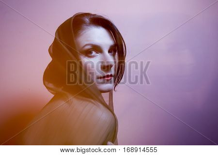 Portrait Of A Woman With Transparent Head Cover In Rays Of Light. Technique Mixed Light