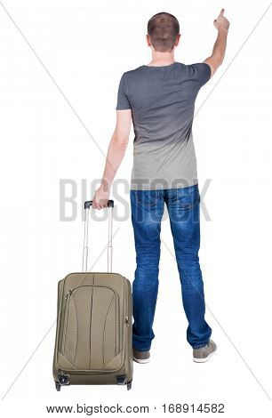 back view of  pointing man  with suitcase. brunette guy pointing .  backside view of person.  Rear view people collection. Isolated over white background.