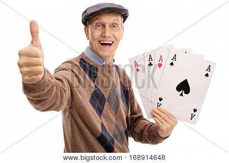 Overjoyed senior holding four aces and making a thumb up gesture isolated on white background.jpg
