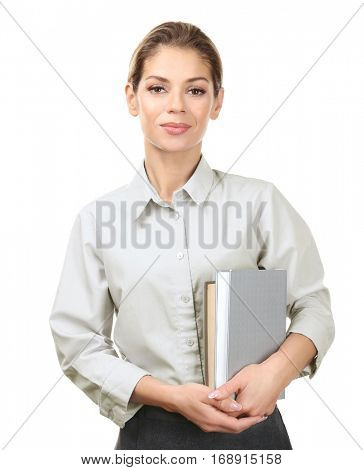 Beautiful woman with books on white background