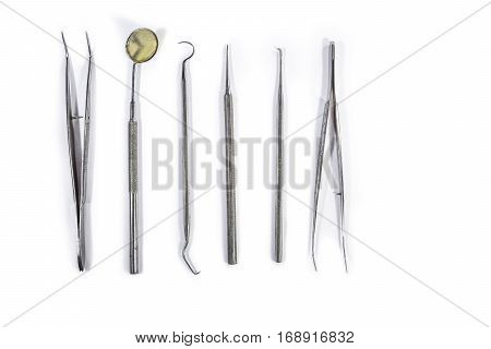 Dental Instruments arranged on white table.concept of teamwork.