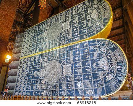 Huge foot of Reclining Buddha's statue Wat Pho Temple or Temple of the Reclining Buddha. Bangkok, Thailand