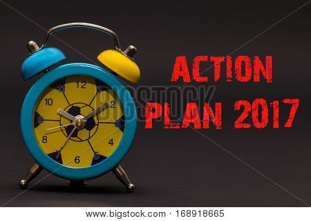 Action Plan 2017 Written With Alarm Clock On Black Paper Background