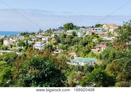 Bluff Hill residential area in the coastal city of Napier New Zealand overlooking the Pacific coast showing colonial style housing mixed with modern properties