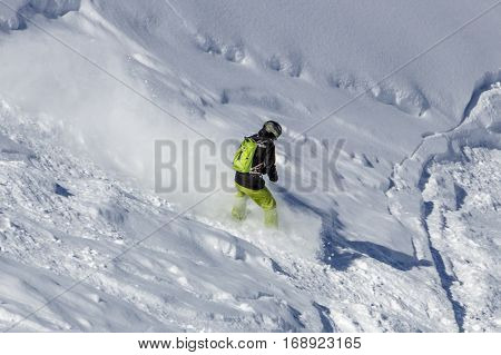 Snowboarder having fun skiing offside on the snowy mountain of the Hintertuxer Glacier (Tuxer Ferner) in Tyol Austria