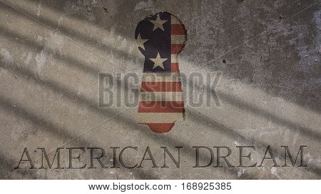 American Dream Written on a Concrete Wall. Keyhole and Flag