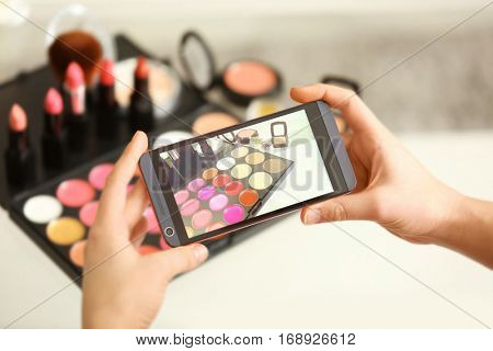 Photo of makeup kit on mobile phone display while shooting