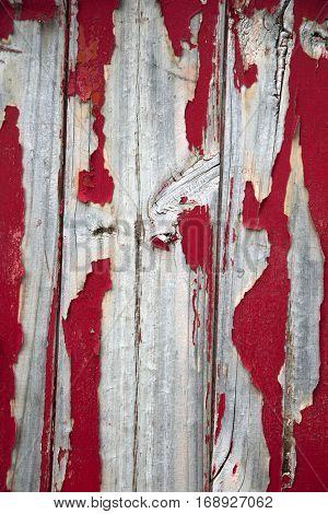 Red peeling painting on wooden barn door