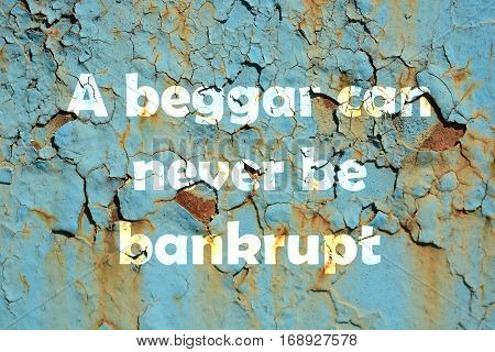 A Beggar Can Never Be Bankrupt. Words Print On The Grunge Metallic Wall