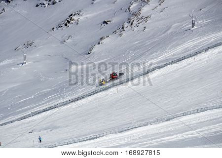 Snowplow clears tracks offside the slopes of the ski region of the Hintertuxer Glacier (Tuxer Ferner) in Tyrol Austria