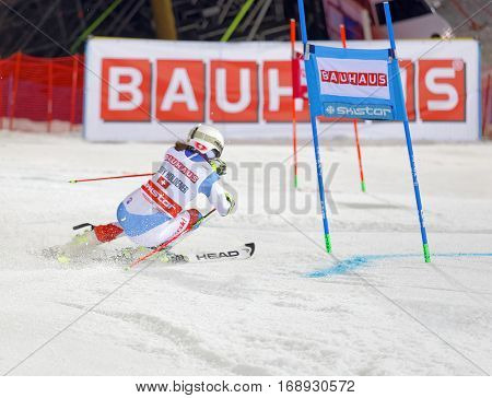 STOCKHOLM SWEDEN - JAN 31 2017: Rear view of Wendy Holdener (SUI) in the parallel slalom downhill skiing at the Alpine Audi FIS Ski World Cup - city event January 31 2017 Stockholm Sweden
