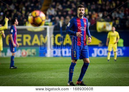 VILLARREAL, SPAIN - JANUARY 8: Pique during La Liga soccer match between Villarreal CF and FC Barcelona at Estadio de la Ceramica on January 8, 2016 in Villarreal, Spain