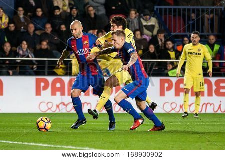 VILLARREAL, SPAIN - JANUARY 8: (C) Pato, (L) Mascherano, Digne (R) during La Liga soccer match between Villarreal CF and FC Barcelona at Estadio de la Ceramica on January 8, 2016 in Villarreal, Spain
